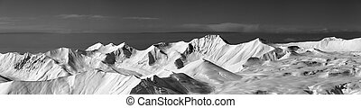 Black and white panoramic view on off-piste slope and snowy...