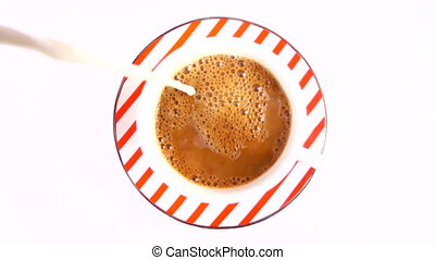 Making Coffee with Milk - milk is pouring from the top into...