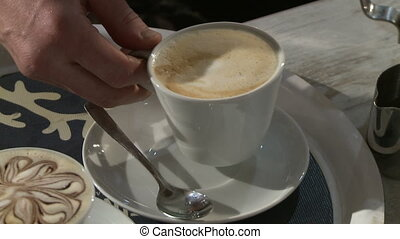 Making coffee in electric coffe machine in a cafe