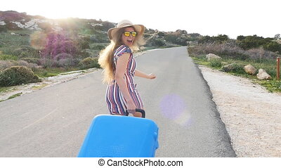 Woman traveler with suitcase running. Travel concept