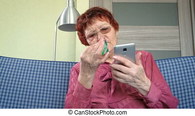 Old lady talking on the phone and holding credit card