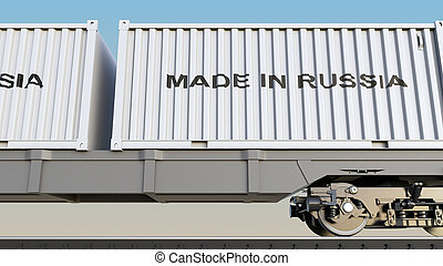 Cargo train and containers with MADE IN RUSSIA caption....