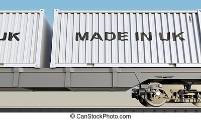 Cargo train and containers with MADE IN UK caption. Railway...