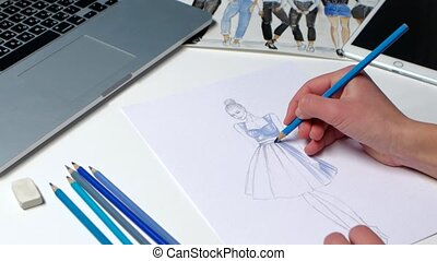 Designer fashion dashed movements paints sketch youth dresses in blue. Close up