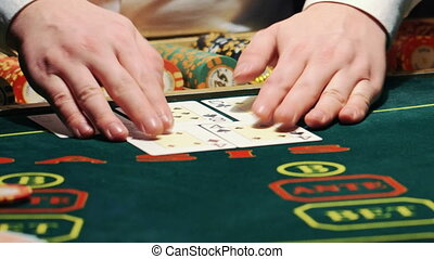 playing poker. dealer deals the cards and the game begins