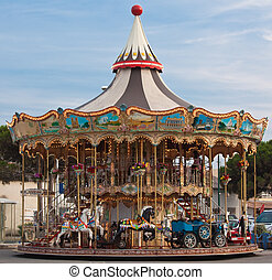 color carousel with horses and cars