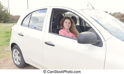 Happy Woman Showing The Key Of New Car - Young Happy Woman...