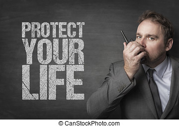 Protect your life text with security man