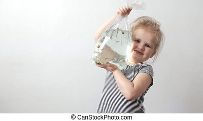 Girl holding bag with a fish