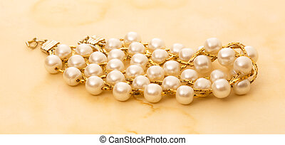 Wristband with white beads - Wristband with golden chain and...
