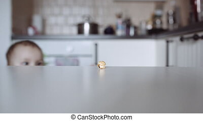Small child taking piece of popcorn from table