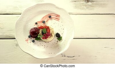 Small cake with berries. Dessert with ice cream. Top view of...