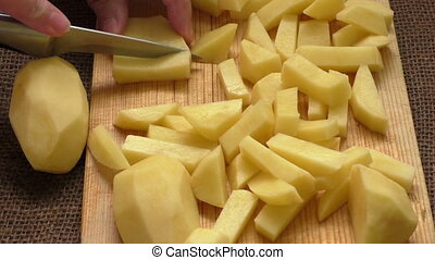 Cutting up the potato into small parts