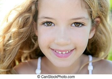 beautiful little girl portrait smiling closeup face looking...