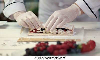 Chef cooking dessert. Berries and mascarpone cheese. Recipe...