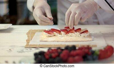Chef's hands cooking dessert.