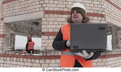 Construction engineer using laptop
