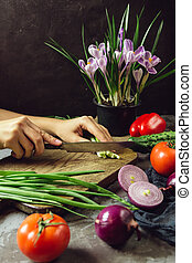 Young woman cooking in the kitchen healthy food, vegetable...