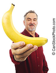 Man offers a yellow banana with outstretched arm