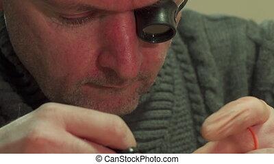 Watchmaker wipes repeater mechanism - Caucasian watchmaker...