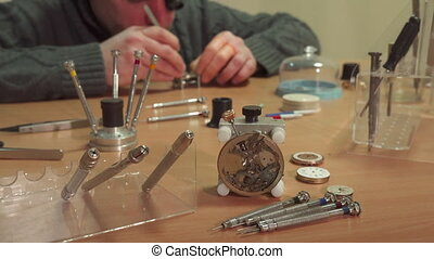 Watchmaker repaires repeater - Middle aged male watchmaker...