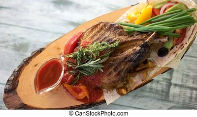 Top view of pork steak. Pita bread, vegetables and sauce.