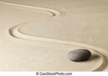 Japanese zen garden stone with line in sand