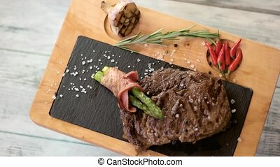Brown steak on a board.