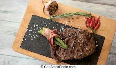 Brown steak on a board.