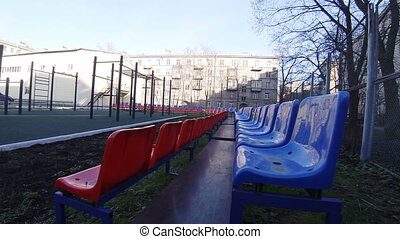 Seats for spectators on the playground. - Seats for...