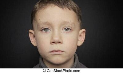 Portrait of a boy close-up on a black background - Portrait...