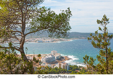 Hill side view of St Antoni de Portmany, Ibiza, on a clearing day in November.