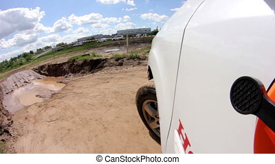 Point of view white crossover drives aling offroad - Point...