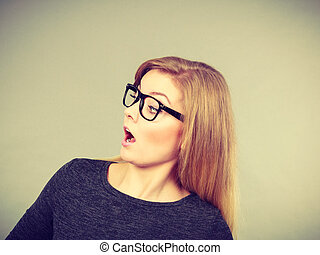 Woman in eyeglasses having shocked face expression