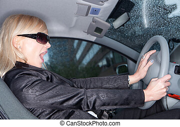 driving a car - An image of a young woman getting shocked...