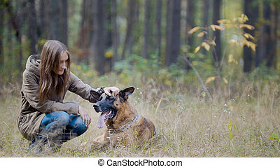 Frienship - girl and her pet in autumn park - german...