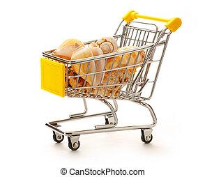 Market pushcart with seashells on white background closeup