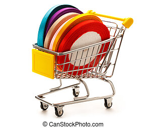 Market pushcart with ribbon rolls in closeup