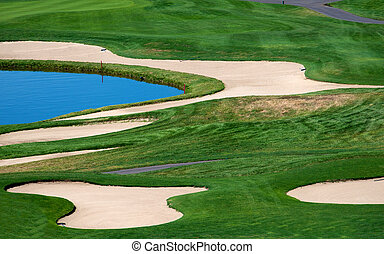 Sand and water hazards on a golf course