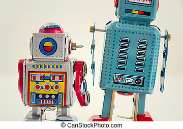 Filtered vintage tin toy robots isolated on white background