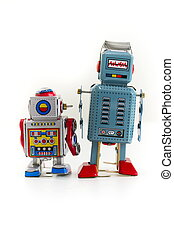 Pair of vintage tin toy robots isolated on white background