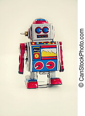 Filtered vintage tin toy robot isolated on white background