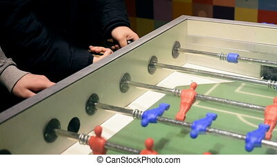 Hands playing table football - Hands play table football. A...
