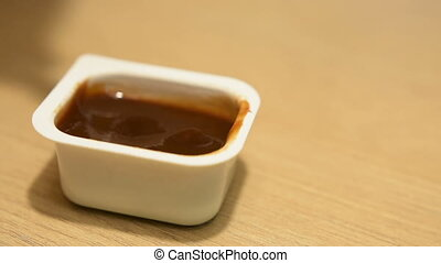 Fries dipped in ketchup - French fries in a barbecue sauce