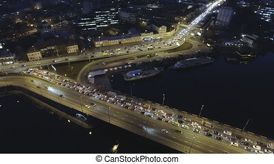Aerial view of night city Kyiv, Kiev, with car traffic. -...