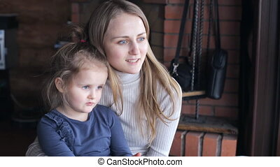 Daughter with mother speaking