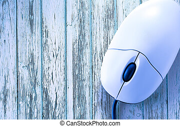 Computer mouse in the blue toning closeup