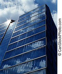 Reflection of Clouds on a Building - Sunny blue sky...