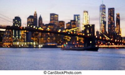 Defocused view of the New York skyline from Brooklyn Bridge...