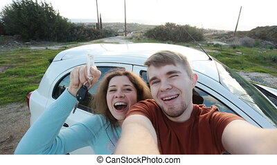 Young couple with a new car. Self portrait